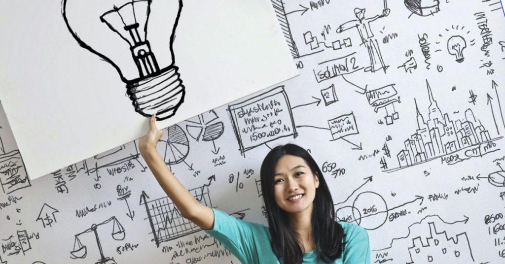 girl holding lightbulb image
