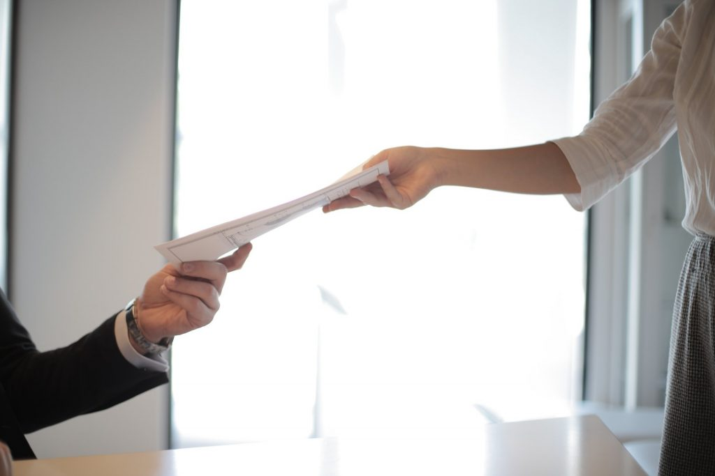 A person handing out a document