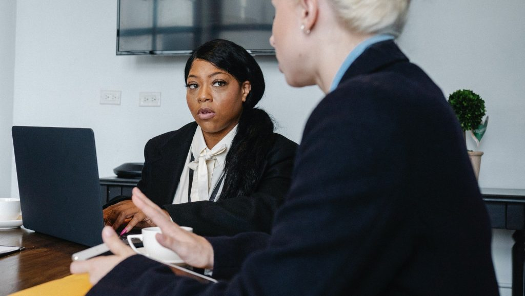 Two women having a discussion in an office