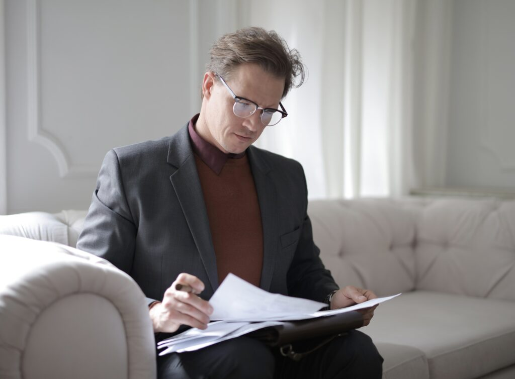 Man looking through documents