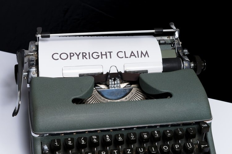 Typewriter with a finished copy of the term Copyright Claim