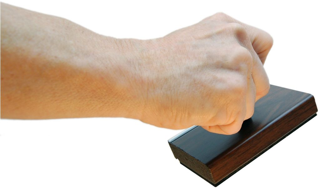 Person holding a stamp pad