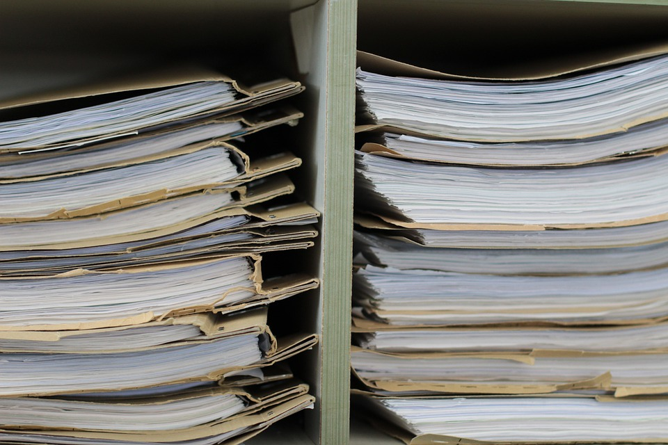 A pile of documents in a shelf