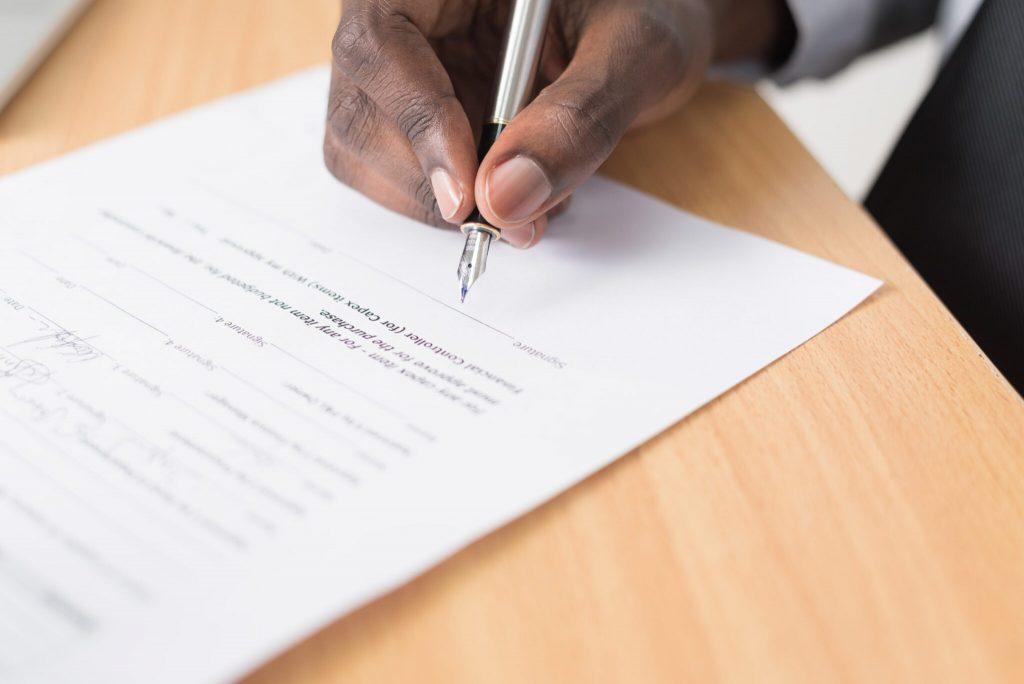 Man signing a written document
