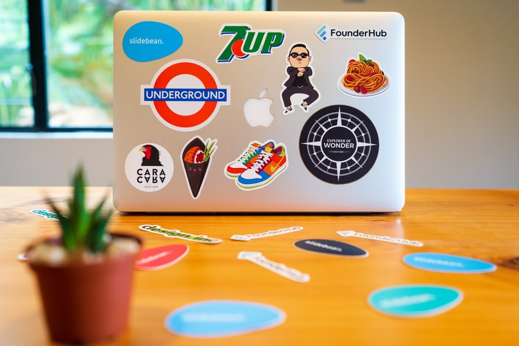 Trademark logo stickers on a laptop
