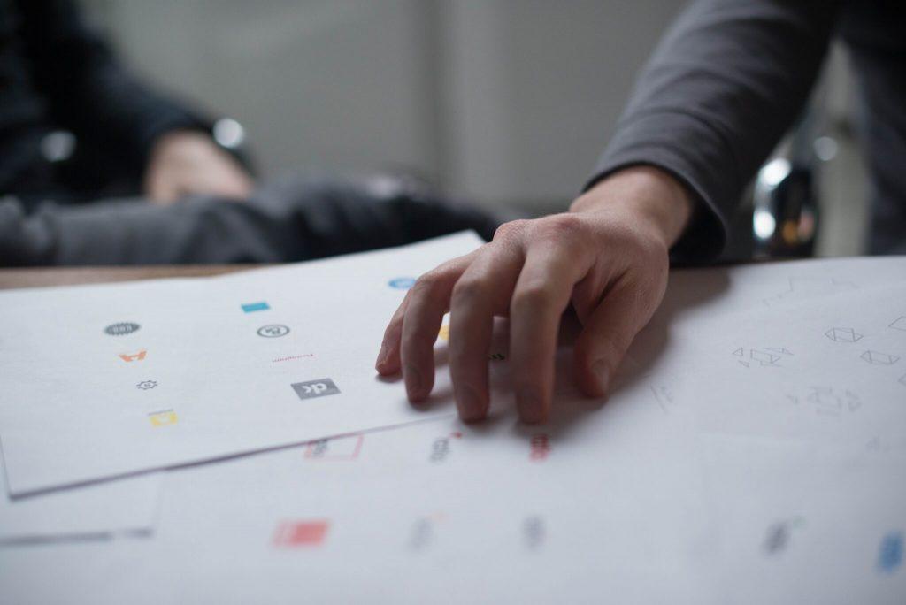 Person picking business logos