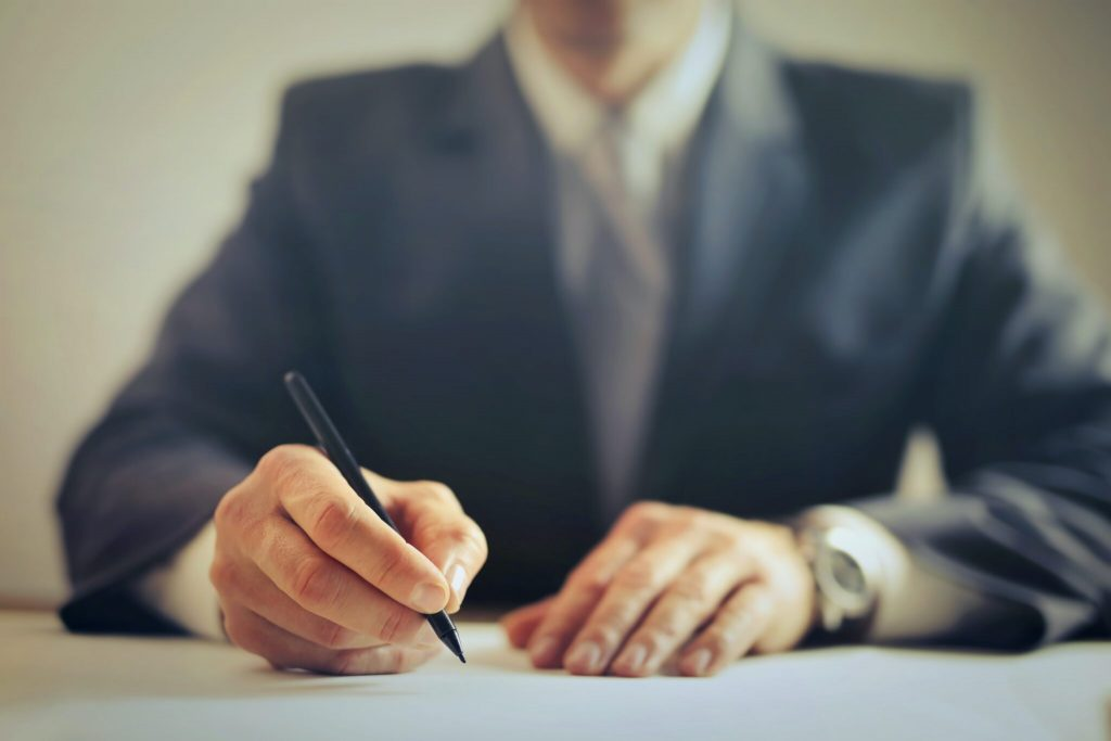 Trademark attorney signing documents