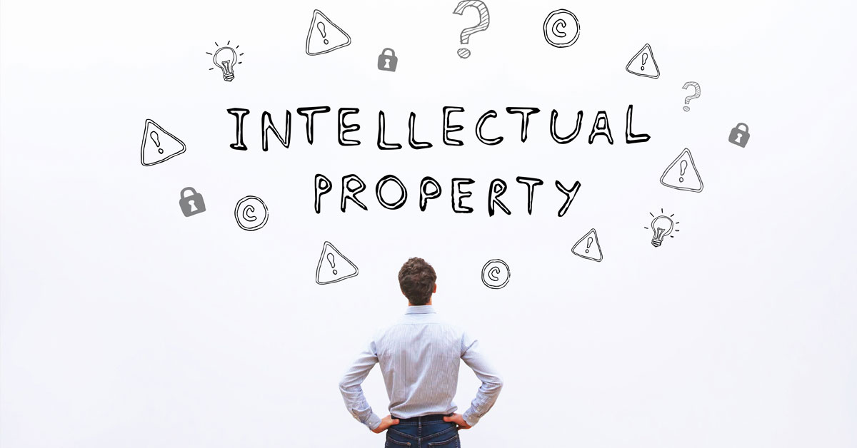 man looking at whiteboard reading intellectual property